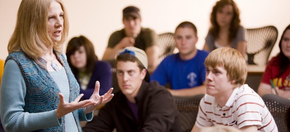 Professor of Economics teaching a group of students