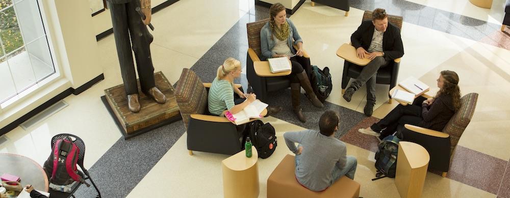 Group of students meeting with Professor Joel Geske