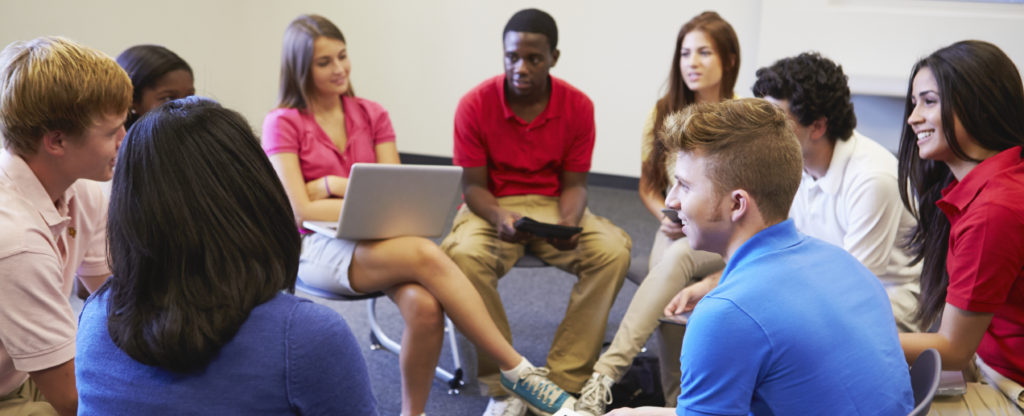 A group of students participating in a class discussion