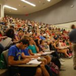 Students in a large lecture hall listening to a faculty member at Iowa State University