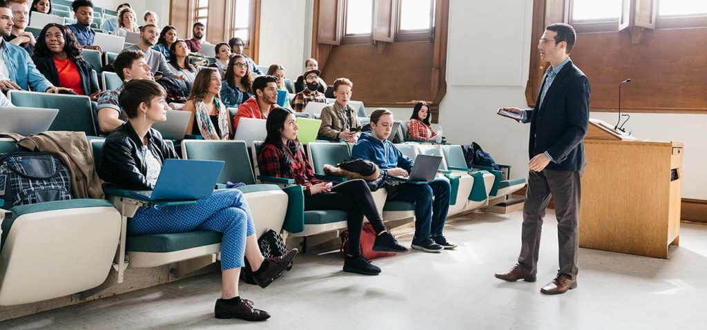 Students and an instructor in a lecture hall using Top Hat