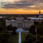 The sun sets over Beardshear Hall on June 27. Max Goldberg/Iowa State Daily