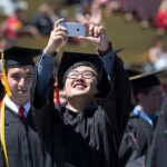 Student taking selfie at a graduation ceremony at Iowa State University