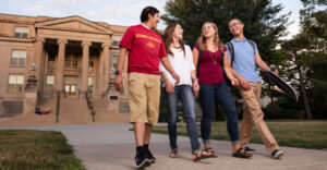 four students walking on central campus at Iowa State University